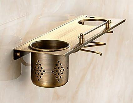 Ducha de cobre antiguo de fotograma completo/Los estantes del cuarto de baño/Los