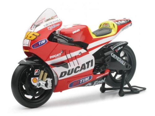 1:12 DUCATI GP11 (VALENTINO ROSSI), Manufacturer: NEW RAY, Manufacturer Part Number: 57063-AD, Condition: New, Stock Photo - Actual parts may vary.