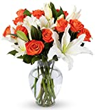 "On the most special of days, show those closest to you how much you think of them through the language of flowers from Benchmark Bouquets. Featuring a marvelous mix of roses and classic white oriental lilies that says your heart is ""true and pure,"" T..."