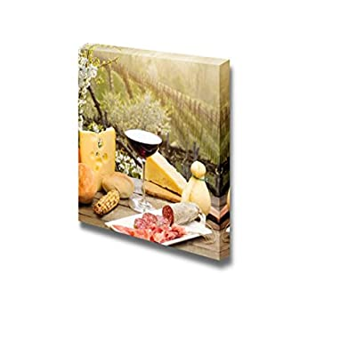 Red Wine Glass with Cheese Anf Ham Against Vineyards Hill 12