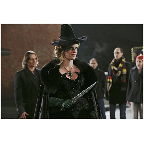 Rebecca Mader Once Upon a Time in black dress and witch hat holding dagger standing in front of cast members 8 x 10 Inch Photo