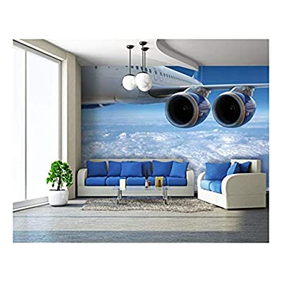 Big Airliner in The Blue Sky with Clouds. - Removable Wall Mural | Self-Adhesive Large Wallpaper - 100x144 inches