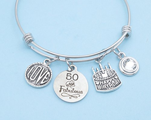 Fifty and Fabulous bangle bracelet in stainless steel with silver toned Love charm and birthday cake charm and genuine Swarovski crystal. (Cake Jewelry Swarovski)