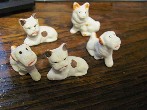 (5 1940s miniature bisque dog)