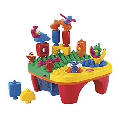 Fisher-Price Pop-Onz Pop 'N Twirl Table Building System: Toys & Games
