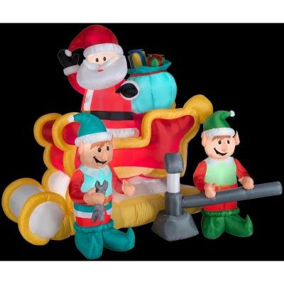Gemmy Animated Airblown Inflatable Santa in a Broken Down Sleigh with Two Elves Jacking It Up - Indoor Outdoor Decorations, 6-foot wide x 5.5-foot tall x 4-foot deep
