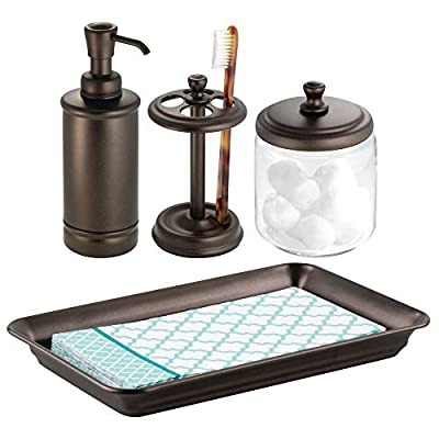 mDesign Classic Bath Accessory Set for Bathroom Vanity Countertops and Sinks, Includes Glass Canister Jar, Toothbrush Holder, Soap Pump Dispenser and Vanity Tray, Set of 4 - Bronze - 4 PIECE SET: Includes 1 glass canister jar with wide metal lid that stores needed vanity staples and provides a decorative accent to your powder room, bathroom vanity, makeup table and more; 1 toothbrush holder that can store up to four toothbrushes; 1 refillable soap pump dispenser that holds up to 8 ounces of soap; 1 vanity tray with raised tray sides keep items contained; Foam pads on the bottom prevent slipping and prevent surfaces from scratches and damage; Pack of 4 STORAGE MADE STYLISH: This vintage-inspired classic canister stores needed vanity staples and provides a decorative accent to your powder room, bathroom vanity, makeup table and more; The toothbrush holder fits perfectly on bathroom vanities and countertops; The reusable and refillable dispenser pump holds soap, dish soap, hand sanitizer or essential oils in a stylish and fashionable container; This tray is the perfect stylish solution to keep small items organized and easy to find FUNCTIONAL & VERSATILE: This space saving bathroom set provides plenty of room for storing a multitude of essentials; Organize your hair ties, clips, elastic bands bobby pins, bows and more; Keep all your family's toothbrushes in one convenient spot with this four spot brush holder; The tray also makes a great multi-purpose drop tray for entryways, hallways, mudrooms and more; Perfect for closet, bedroom, and nightstands; Great for apartments, condos, dorm rooms, RVs and campers - bathroom-accessory-sets, bathroom-accessories, bathroom - 41HYKSprM0L. SS400  -