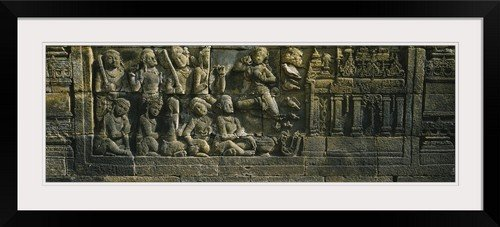 GreatBIGCanvas ''Statue carved on the wall of a temple, Borobudur Temple, Java, Indonesia'' Entitled Photographic Print with Black Frame, 36'' X 12'' by greatBIGcanvas