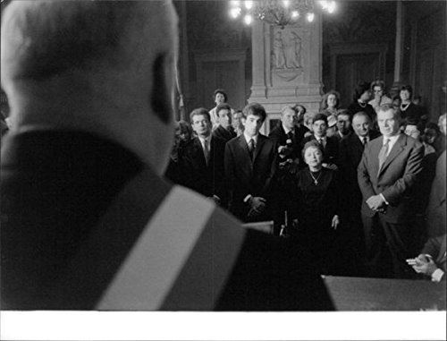 Vintage photo of Edith Piaf standing.