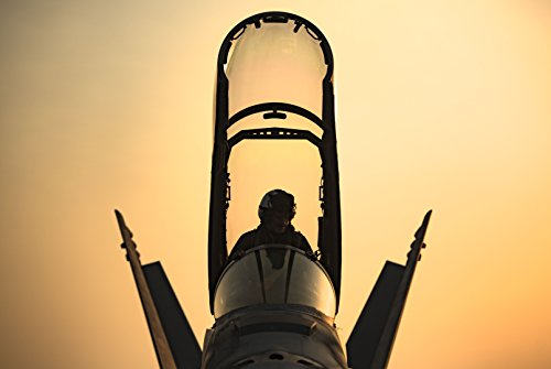 A pilot climbs into the cockpit of an F/A-18F Super Hornet assigned to the Fighting Swordsmen of Str