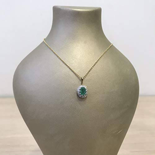 Genuine natural 0.75 carat oval emerald gemstone necklace set in a solid two tone gold halo design on yellow gold rolo chain