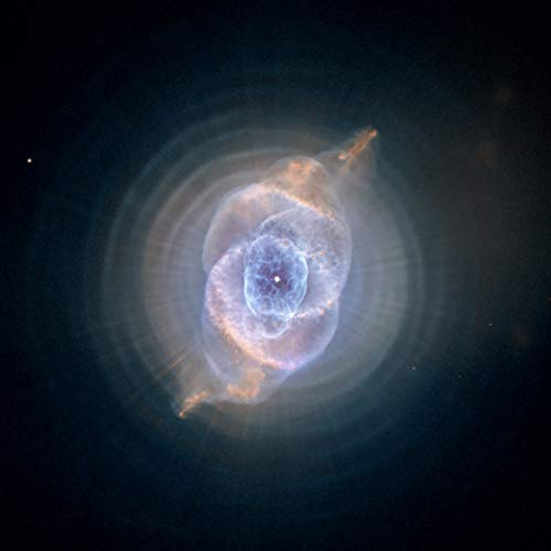 Home Comforts Laminated Poster Hubble Space Telescope The Cat's Eye Nebula NASA S Vivid Imagery Poster Print 11 x 17