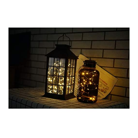 Solar Outdoor Lantern, Waterproof Hanging Solar Lantern with 30 LED Fairy Copper String Lights for Patio, Garden, Lawn, Pathway (Warm White) - CLASSIC DESIGN: Simple and elegant black frame rectangle shape with 30 LED warm fairy string lights, create a unique retro romance. SAFE LONG LIGHTING: Choosing the most popular string of lights inside the lantern instead of traditional candles, guarantees sufficient illumination without the danger of open flames. And after full charged, the solar lantern will automatically turn on at night and light up for 8 hours. PERFECT OUTDOOR DECOR: A movable hanging ring can be easily hung on anywhere, very suitable for your balcony, hallway, porch, courtyard, patio, garden, lawn. - patio, outdoor-lights, outdoor-decor - 41HtZioT%2B6L. SS570  -