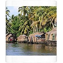 Mug of Asia, India, Kerala (Backwaters). Kerala houseboats docked alongside a (13921588)