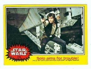 (Han Solo with Blaster trading card Star Wars 1977 Topps #174 aims for trouble Harrison Ford)