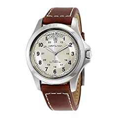 Brushed and polished stainless steel case (40 mm in diameter, 11 mm thick), Transparent screw-down caseback, Beige dial, Silvertone luminescent hands, Black Arabic numerals, 24-hour display, Day and date window at the 12 o'clock position, Sap...