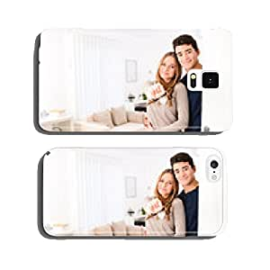 happy young couple in new house showing their keys cell phone cover case iPhone5