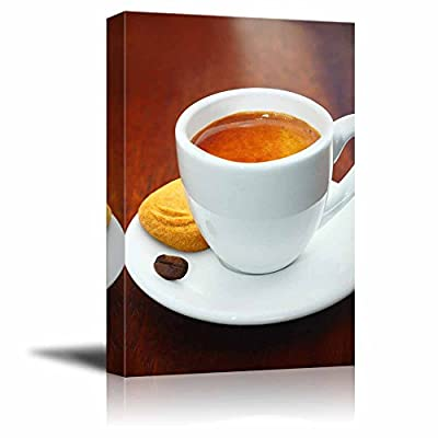 Cup of Freshly Brewed Frothy Espresso Coffee Served with a Crisp Golden Biscuit