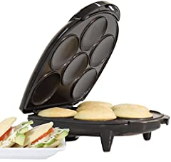 Have your Latin bakery favorites in just 7 minutes with the Holstein Housewares Arepa Maker. Whether you fill them with cheese or shredded beef, this maker allows you to prepare 6 perfectly round and golden arepas in no time. The non-stick cooking su...