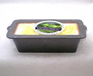 Swan Creek Vanilla Pound Cake Scented Candle in a Decorative Cast Iron Loaf Pan.
