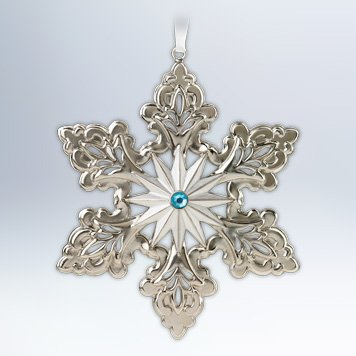 silver color snowflake tree ornament with blue gemstone rhinestone middle
