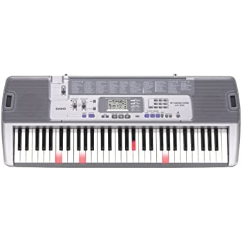 old model casio lk 100 lighted keyboard with lcd display musical instruments. Black Bedroom Furniture Sets. Home Design Ideas