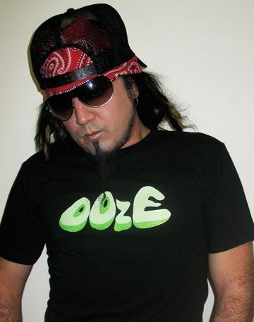 Ooze Ooze By Omen Black Unisex T-Shirt with Gory Green Glow in the Dark Ooze Logo! In Small, Medium, & Large. Comes with Free Cootie Pool CD/Mp3 Remix with Each Order! (Liquid Dame)