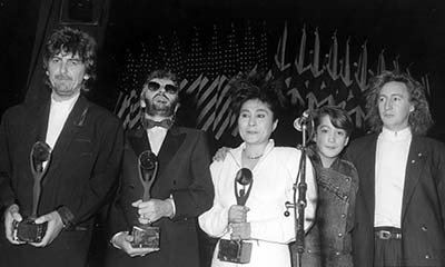 Photo George Harrison Ringo Starr Yoko Ono (all holding awards) and Ono and Lennon's children Sean and Julian Lennon at Rock & Roll Hall of Fame.