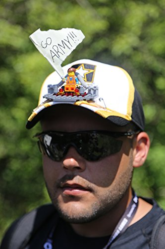 U.S. Army Spc. Michael Sheeley, Warrior Transition Unit, Fort Bragg, N.C., displays the hat and sign