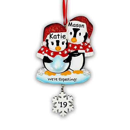 Personalized Pregnant We're Expecting Penguin Couple with Baby Egg with Glittered Santa Stocking Cap and Scarves and Snowflake Detail Hanging Christmas Ornament with Custom Name and Date (Optional) -