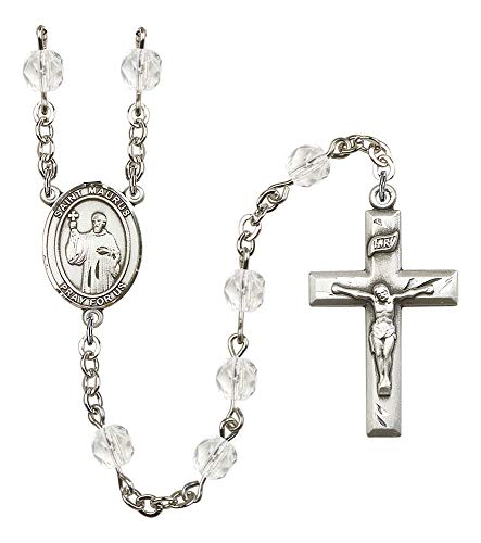 Silver Plate Rosary Features 6mm Crystal Fire Polished Beads. The Crucifix Measures 1 3/8 x 3/4. The Centerpiece Features a St. Maurus Medal. Patron Saint Cobblers/Cold
