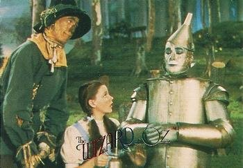 Tin Rust (Dorothy Oiling Away the Rust of the Tin Man trading card (The Wizard of Oz) 1996 DuoCards #37)