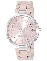 Nine West - Reloj de pulsera para mujer con cristales acentuados de goma, Rosado/Plateado