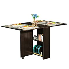 The Tiptiper Dining Table is a perfect centerpiece for your dinette, or small apartment. It features drop-leaf sides that expand the table surface as desired. It can be used as a desk, dinner table or a craft table. It's pretty cool to have t...