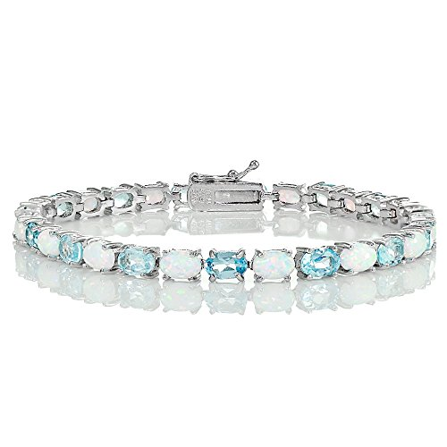 (Ice Gems Sterling Silver Blue Topaz and Created White Opal 6x4mm Oval Tennis Bracelet)