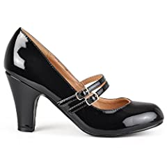 Dress to impress in Mary Jane pumps by Brinley Co. These shoes feature patent leather uppers with classic round toes and double straps across the vamps. A small chunky heel completes the design of these practical and stylish pumps.