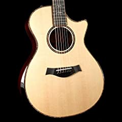Here's a classy guitar! A Taylor 912ce Grand Concert acoustic-electric guitar with a natural finish. The Ebony armrest adds comfort and beauty, especially when contrasted with the understated Sitka Spruce top. The Indian Rosewood back and sid...