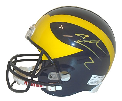 - Michigan Wolverines Charles Woodson Signed Hand Autographed Riddell Full Size Football Helmet with Proof Photo of Signing and COA, 1997 Heisman Trophy Winner, Oakland Raiders, Green Bay Packers