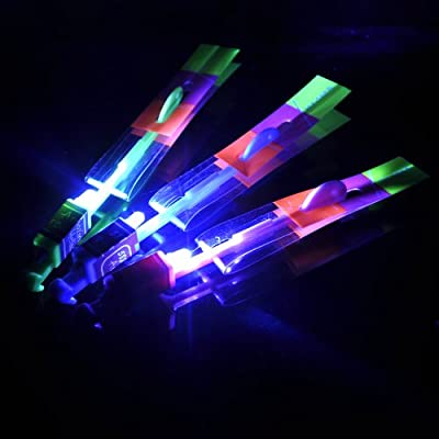 10pcs Amazing Flying Toy Led Arrow Helicopter Copter / Elastic Powered LED Arrow Helicopter, Looking Beautiful When It Flies in the Dark: Toys & Games