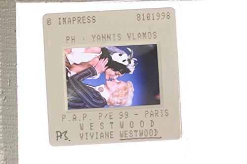 (Slides photo of Dame Vivienne Isabel Westwood, kissing her model.)