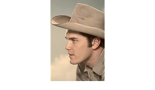 5d433314e5af4 Jeffrey Hunter profile cowboy hat clouds in background 24x36 Poster at Amazon s  Entertainment Collectibles Store
