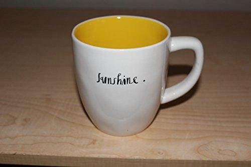 Rae Dunn Sunshine in hand written script with bright yellow interior coffee mug