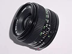 This is a wide angle lens used on manual focus Canon SLR camera bodies. It is not intended to mount or work on Canon EOS cameras without an adapter. Adapters will allow the lens to mount on EOS series but will only work in manual mode.