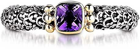 18KY & Sterling Silver This one of a kind sterling silver 18kyellow gold amethyst Sara Blaine ring looks great alone or stacked with it's peridot and blue topaz counterparts