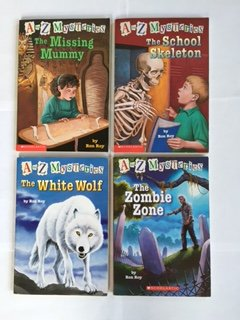 A to Z Mysteries (4 Books) The Missing Mummy -- The School Skeleton -- The White Wolf -- The Zombie Zone, By Ron Roy (A To Z Mysteries The Missing Mummy)