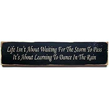 Life Isnt About Waiting For The Storm Wood Sign