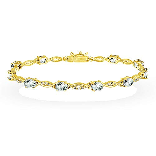 - GemStar USA Yellow Gold Flashed Sterling Silver Aquamarine and White Topaz Oval-Cut Swirl Tennis Bracelet