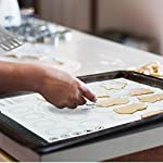 Beckon Ware XL Silicone Baking Mat for Pizza, Pastry, Cookies, Dough Rolling, Fondant, Etc. Black 11 NON-STICK COATING: If you never used a baking mat before it is life changing. No need to brush oil on the mat when baking food as it is easy to be separated. This mat can be used as a non-stick sugar pastry mat as well. Prep foods and store on mat in refrigerator and transfer directly to oven. Just rinse the silicone mat with water or wipe it slightly with a soft cleaning cloth, or brush slightly with a little dish detergent. You will see how you will not miss working with pans. BUILT-IN CONVERSION SYSTEM: Cook like a professional with this interesting find. Are you a pastry chef? Or do you just like baking, handling pizza flour or cooking? This mat is for you. Roll it, shape it, bake it! Cookies, Pizza, Pies, Wings, Fries, Roasted Veggies, etc. Use conversion charts for easy guide measurements. So no more guesswork or internet look-ups. Cookie and dough circles to guide your dough and pastry size. Extra large pizza is NOT a problem either. Go for it! HEAT AND COLD RESISTANT: It is states of the art. Nothing to worry about when Beckon Ware is behind the product. This mat goes sub degrees -40 to 482 Fahrenheit. Our silicone baking mat passed the inspections of SGS, FDA, and LFGB. This unique mat is composed of fiberglass and is coated on both sides with non-stick silicone, allowing for the dough to be rolled out effortlessly.