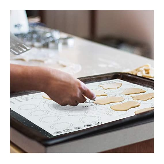 Beckon Ware XL Silicone Baking Mat for Pizza, Pastry, Cookies, Dough Rolling, Fondant, Etc. Black 2 NON-STICK COATING: If you never used a baking mat before it is life changing. No need to brush oil on the mat when baking food as it is easy to be separated. This mat can be used as a non-stick sugar pastry mat as well. Prep foods and store on mat in refrigerator and transfer directly to oven. Just rinse the silicone mat with water or wipe it slightly with a soft cleaning cloth, or brush slightly with a little dish detergent. You will see how you will not miss working with pans. BUILT-IN CONVERSION SYSTEM: Cook like a professional with this interesting find. Are you a pastry chef? Or do you just like baking, handling pizza flour or cooking? This mat is for you. Roll it, shape it, bake it! Cookies, Pizza, Pies, Wings, Fries, Roasted Veggies, etc. Use conversion charts for easy guide measurements. So no more guesswork or internet look-ups. Cookie and dough circles to guide your dough and pastry size. Extra large pizza is NOT a problem either. Go for it! HEAT AND COLD RESISTANT: It is states of the art. Nothing to worry about when Beckon Ware is behind the product. This mat goes sub degrees -40 to 482 Fahrenheit. Our silicone baking mat passed the inspections of SGS, FDA, and LFGB. This unique mat is composed of fiberglass and is coated on both sides with non-stick silicone, allowing for the dough to be rolled out effortlessly.
