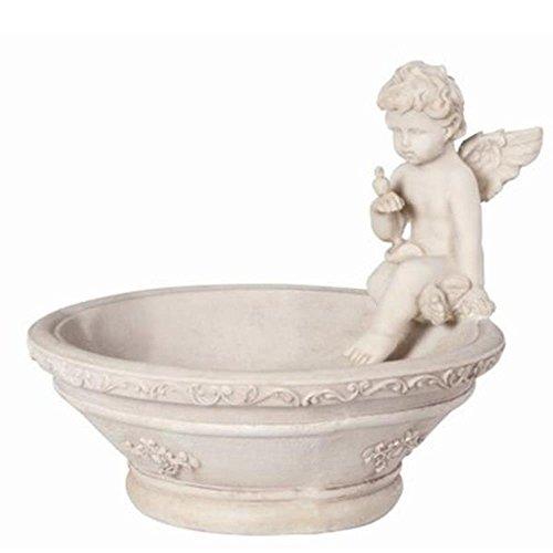 Pflanzschale mit Engelfigur und Vogel auf Hand sitzend.